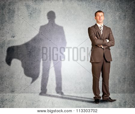 Businessman with superman shadow