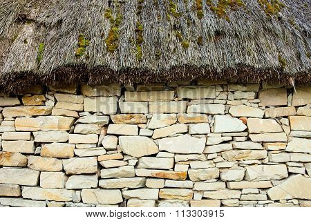Stone Wall Under The Thatched Roof