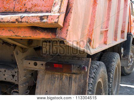 Orange Dump Truck. Rear View.