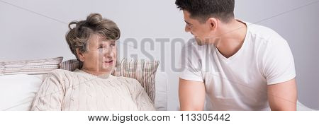 Grandson Talking With Grandmother