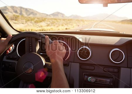 Close Up Of Driver's Hands On Car Steering Wheel