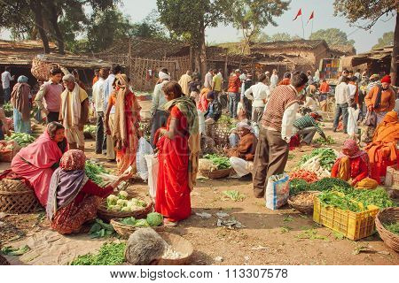 Women And Villagers Buying Vegetables For The Families On Cheap Village Market