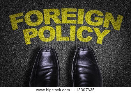 Top View of Business Shoes on the floor with the text: Foreign Policy