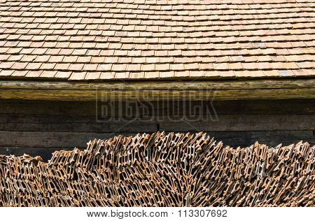 Tiled Roof And Stack Of Roof Tiles