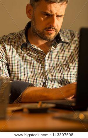 Mature Man Working On Computer