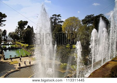 Tivoli, Italy - April 10, 2015: Tourists Visiting Fountain Of Neptune And Organ In Villa D'este In T