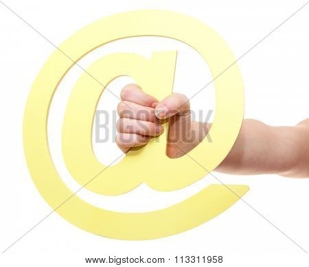 Hand holding at sign. All on white background.