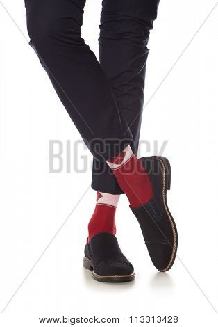 Man leg in suit and red socks, isolated on white