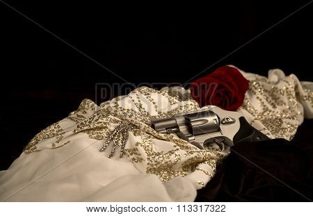 Revolver laying on a Woman's Evening Dress