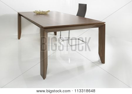 NEW FURNITURE LINE , MODERN DESIGN,  STRAIGHT LINES . TABLE WITH CHAIR . MATERIALS : WOOD, METAL, LEATHER