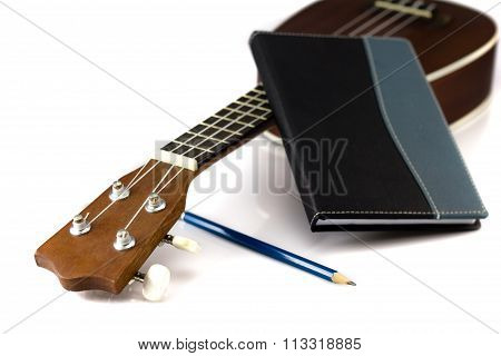 Notebook , Pencil And Ukulele