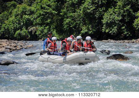 Kiulu Sabah Malaysia - October 22, 2011.Group of adventurer enjoying water rafting activity at Kiulu