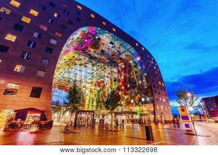 modern market hall in Rotterdam, Netherlands, at night