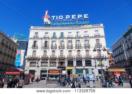 MADRID, SPAIN - MARCH 16, 2015: square Puerta del Sol in Madrid, with unidentified people. Its one of the best known and busiest places in Madrid and the centre of the radial network of Spanish roads