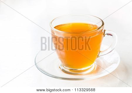 Hot Aromatic Honey Tea In Transparent Cup And Saucer