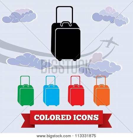 Bag icon. Luggage, baggage symbol. Black, red, green, blue, orange colored signs on light sky with c