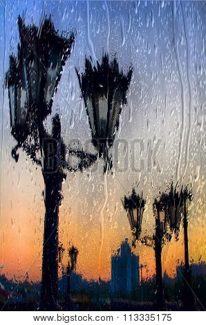 Yekaterinburg City Throw The Silhouettes Of The Street Lights, View Through The Wet Glass In A Rainy