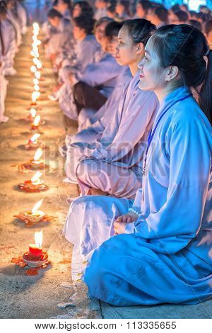Radiant beauty facial female Buddhists inside each candle