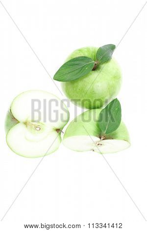 green fresh ripe apple with half isolated on white background