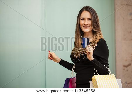 Attractive Latin Woman With A Credit Card