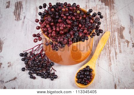 Fresh Elderberry With Wooden Spoon On Old Wooden Background, Healthy Food