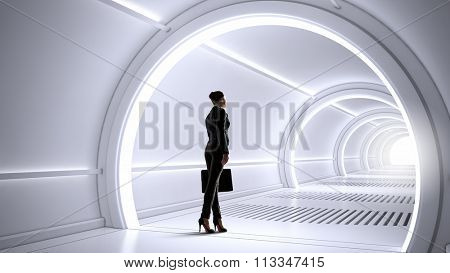Woman in futuristic interior