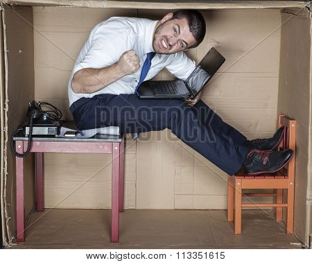 Angry Businessman Sitting On The Table
