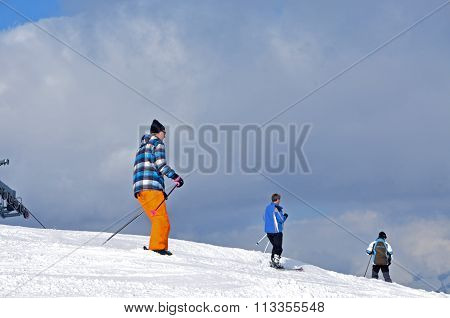 Skiers Skiing In The Alps