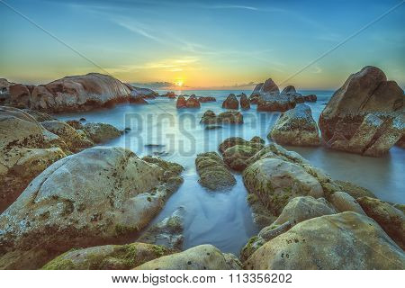 Sunrise over sea reef Binh Thuan