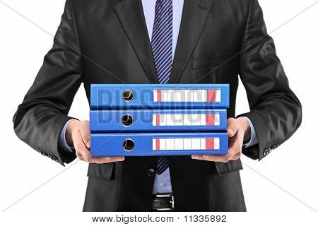 A Close Up Of A Businessman Holding Three Blue Folders
