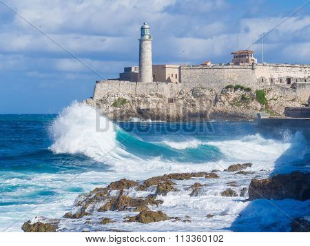 The Castle and lighthouse of El Morro , a symbol of the city of Havana