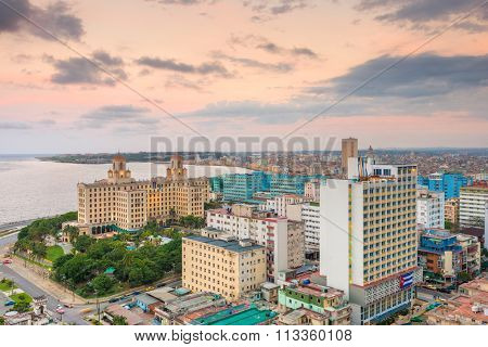 Panoramic view of Havana at sunset with a view of the Vedado neighborhood and the buildings next to the Malecon seawall