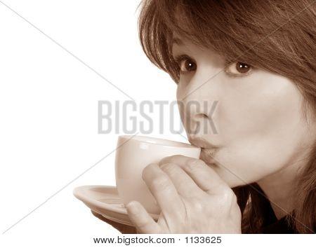 Woman Sips Her Tea