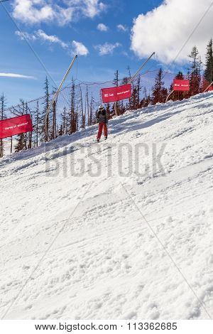 Girl During Downhill Skiing.