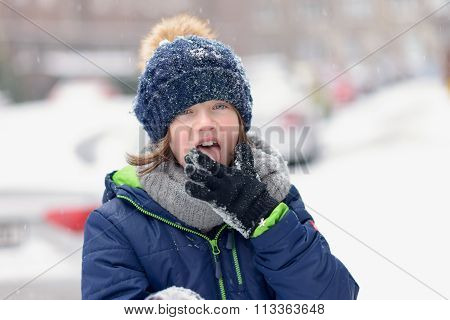 Young Girl Tasting The Snow