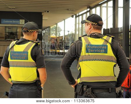 Protective Services officers at a train station