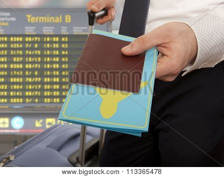 Passport control. Traveling businessman handing passport and ticket