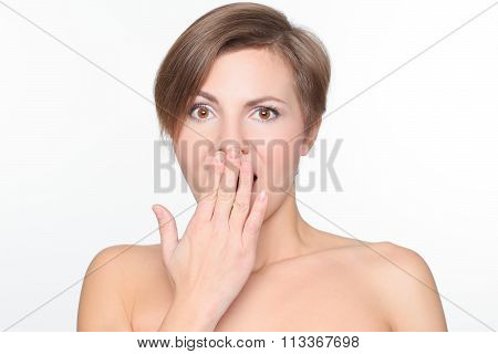 portrait of a beautiful woman with bare shoulders and short hair. she covered her mouth with his han