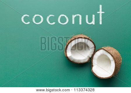 halved coconut on green chalkboard