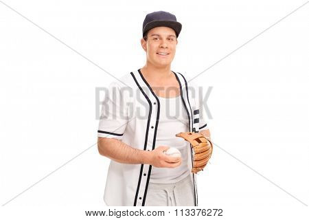 Young man in a baseball uniform holding a baseball and looking at the camera isolated on white background
