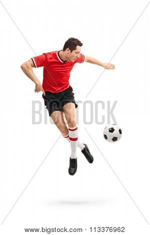 Full length portrait of a skillful football player performing a rainbow flick shot in mid-air isolated on white background