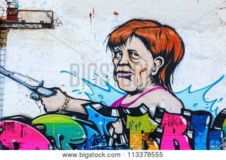 mural of German Chancellor Angela Merkel