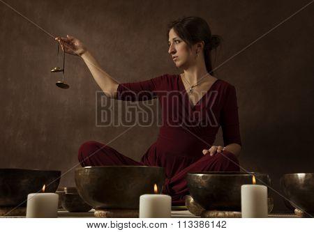 Woman Playing Tingsha (tibetan Bells)