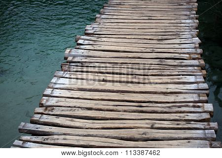 Timber Walkway Across Lake