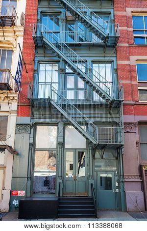 old residential buildings with fire escape stairs in Soho, New York City