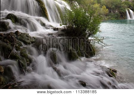 Misty Waterfalls Flowing Into Lake