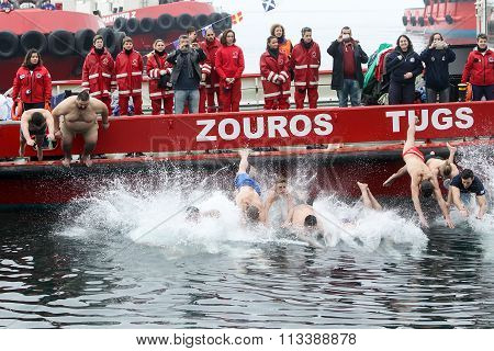 People Plunge To Retrieve A Wooden Cross Thrown Into The Sea, During The Blessing Of The Water Cerem