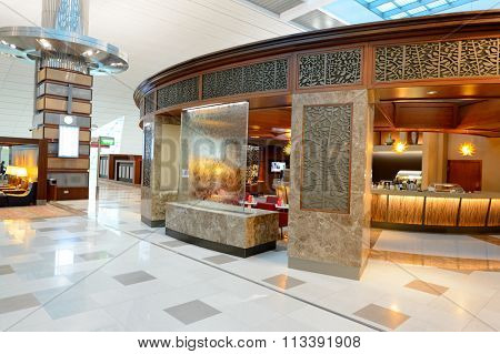 DUBAI, UAE - NOVEMBER 21, 2015: interior of Emirates business class lounge. Emirates is the largest airline in the Middle East. It is an airline based in Dubai, United Arab Emirates.