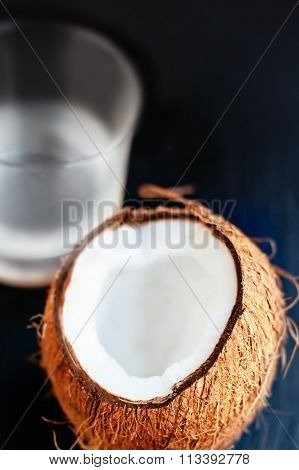 Coconut With Coconut Water In A Glass. Coconut Milk. Coco Nut Cut In Half