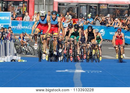 STOCKHOLM SWEDEN - AUG 23 2015: Spanish triathletes Gomez Hernandez and large group of competitors cycling uphill in the Men's ITU World Triathlon series event August 23 2015 in Stockholm Sweden